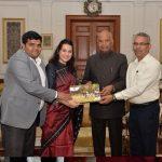 Priyanka Kothari and Bhasker Prakash receiving award from president