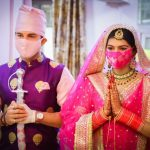 Manish Raisinghan and Sangeita Chauhaan Wearing Mask in wedding